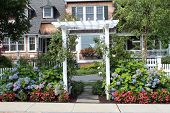pic of entryway  - floral entryway to a summer home with lots of windows - JPG