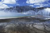 USA Wyoming Yellowstone National Park Grand Prismatic Spring mist over hot spring in winter landscape