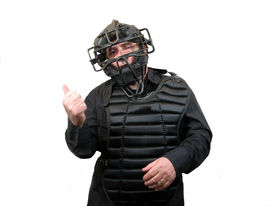 pic of umpire  - An umpire with a mask and chest protector with his thumb up signaling you