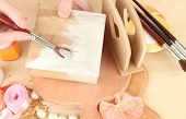 Handmade wooden box and art materials for decor, on table