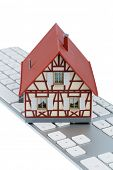 residential house on keyboard symbol photo for home purchase and rental on the internet