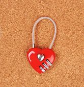 heart shape lock locked up with wood background