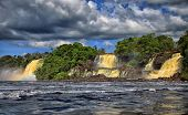 picture of canaima  - powerful waterfall in tropics and a lake in front - JPG