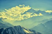foto of snowy hill  - Snowy peaks of Himalayas and clouds in a soft light - JPG