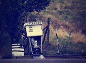 an old gas pump done with a retro vintage instagram filter
