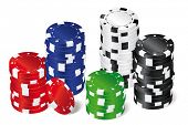Stacks of Poker chips. Five stacks of red, green, blue, white and black poker chips with playing card symbols isolated on white