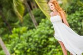 young beautiful woman in bridal wedding dress on natural background