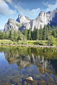 Phenomenally scenic Yosemite Valley. The mirror surface of the Merced river reflects the picturesque