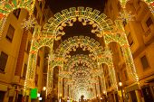 Beautiful night lights in Fallas fest of Valencia in calle Sueca street Spain
