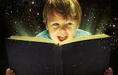 image of little boys only  - Child opened a magic book - JPG