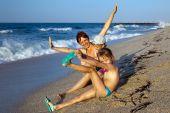 Mum With Children On A Beach