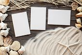 marine items on a wooden boards against sandy background, blank sea  cards