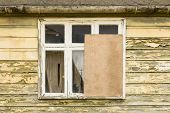 Partly Boarded Up Window