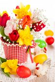 Bouquet of spring flowers and easter eggs for Easter