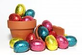 Colored Easter Eggs And Terracotta Flower Pot