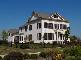 image of white vinyl fence  - Two story new home built to look like an old historical home complete with the added on look - JPG