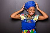 beautiful african model in traditional attire posing on black background