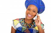 pretty african zulu woman talking on smart phone isolated on white background