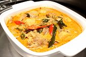 Bowl Of Curry Chicken Cooked With Coconut Milk With Chilli Garnishing.