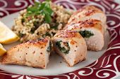 Grilled chicken breast stuffed with spinach, served with bulgur wheat salad