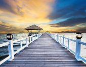 wood piers and sea scene with dusky sky use for natural background ,backdrop