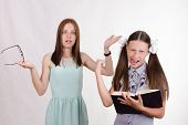 stock photo of deuce  - Pupil refuses to listen to the teacher and mocks her - JPG