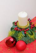 Natural Advent Decoration With Candle And Baubles