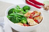 stock photo of snow peas  - Grilled chilli chicken with steamed broccoli snow peas green beans and ginger - JPG