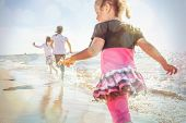 kids running at the beach, runners have motion blur