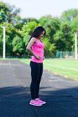 woman sport checking cellulite waist