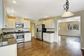 Kitchen With White Cabinets And Granite Tops