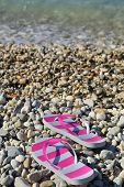 Flip flops on pebbled beach closeup Vassiliki Lefkada