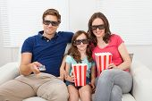Smiling Family Watching 3D Movie At Home