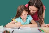 Woman Assisting Daughter In Studying