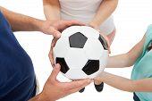 Family Holding Soccer Ball