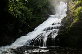 foto of gap  - A waterfall in a forest - JPG