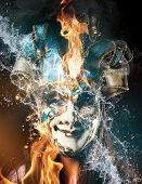 Colorful Venetian carnival mask with fire and water, close-up.