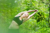 Lady practicing yoga in the nature.