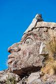Inca face sculpture in the peruvian Andes at Puno Peru