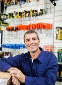 Portrait of happy mature worker in hardware shop