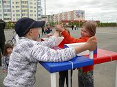 Nadym, Russia - June 28, 2008: Competitions On Arm-wrestling. Strange Children: A Boy And A Girl Str