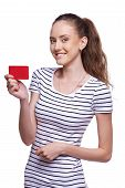 Happy smiling female showing blank credit card