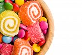 top view of colorful candy on white background