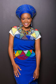 foto of zulu  - gorgeous african zulu woman standing against black wall - JPG