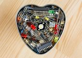 The heart of electronic technology - metal heart with electronic elements