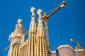 BARCELONA, SPAIN - DEC 24, 2014: La Sagrada Familia - the impressive cathedral designed by Gaudi, which is being build since Mar 19, 1882 and is not finished yet.