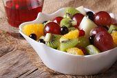 Fruit Salad And Grape Juice Close Up. Horizontal