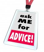 Ask Me for Advice words on a badge or name tag worn by a worker or employee at a store or business offering help, assistance, support or service