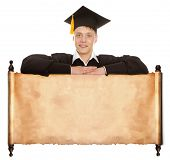 Excited college graduate standing behind vintage blank panel isolated on white background
