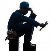 one  repairman worker sad fatigue failure silhouette in studio on white background